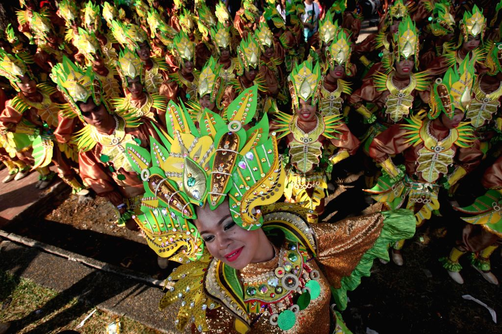 Dancers wearing colorful costumes perform during the annual Aliwan Fiesta, a cultural annual event, in Manila, the Philippines, on April 25, 2015. (Xinhua/Rouelle ...