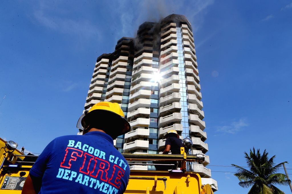 MANILA, April 29, 2019 - Firefighters try to put out the fire engulfing the residential building named Pacific Coast Plaza in the Manila suburban city of Paranaque, the Philippines, April 29, 2019. ...