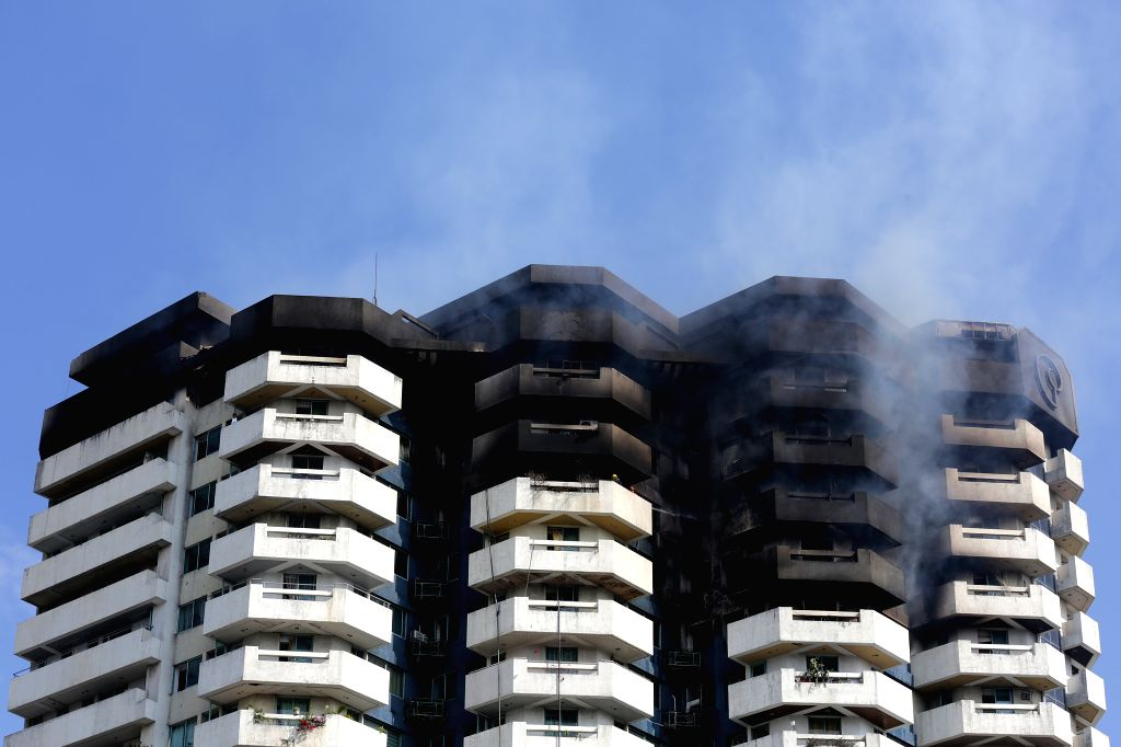 MANILA, April 29, 2019 - Smoke comes out from the residential building named Pacific Coast Plaza in the Manila suburban city of Paranaque, the Philippines, April 29, 2019. At least one woman died in ...