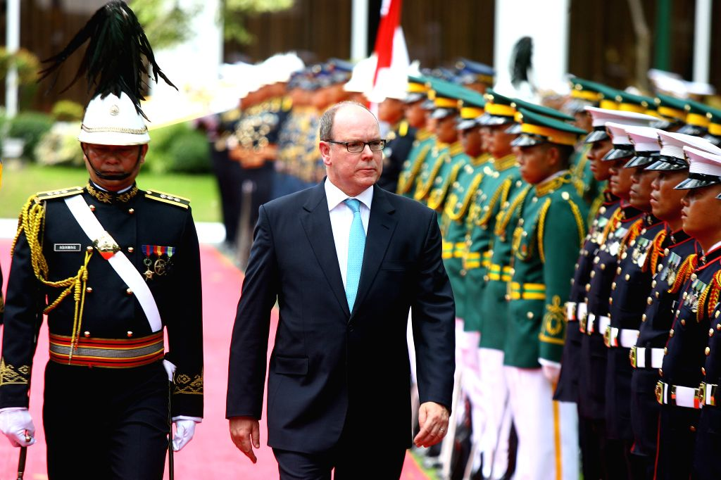 MANILA, April 7, 2016 - Prince Albert of Monaco II (C) reviews the guards of honor during a welcome ceremony at the Malacanan Palace in Manila, capital of the Philippines, on April 7, 2016. Prince ...