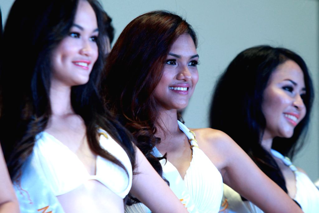 Contestants pose during the 2014 Miss Global Philippines presentation in Manila, the Philippines, Aug. 12, 2014. The winner of 2014 Miss Global Philippines pageant ..