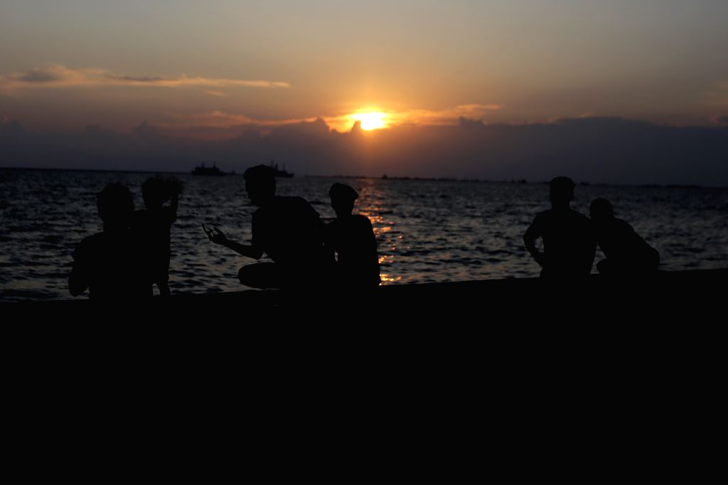MANILA, Aug. 16, 2019 - People watch the sunset in Manila Bay in Manila, the Philippines, Aug. 16, 2019.
