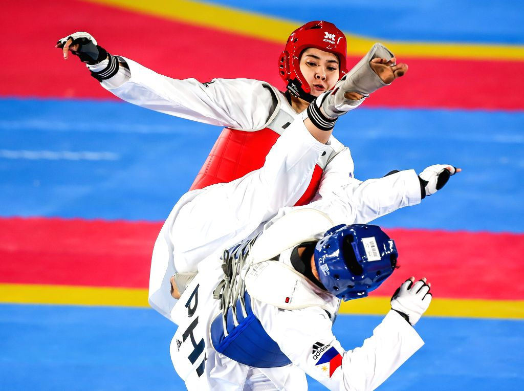 MANILA, Dec. 8, 2019 - Kirstie Elaine Alora of the Philippines competes against Seavmey Sorn (Top) of Cambodia during the women's under 73kg taekwondo final at the Southeast Asian Games 2019 in ...