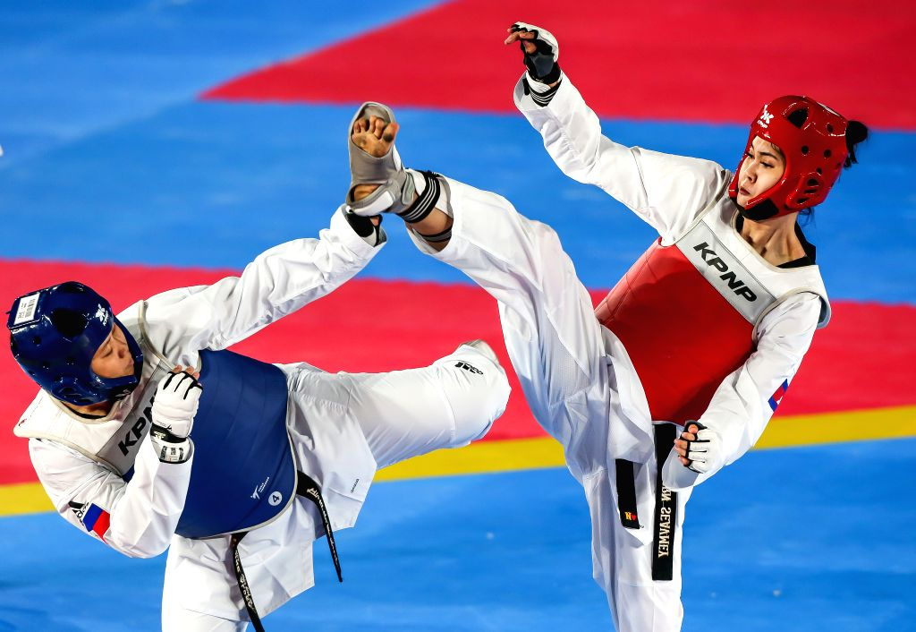 MANILA, Dec. 8, 2019 - Kirstie Elaine Alora of the Philippines competes against Seavmey Sorn (R) of Cambodia during the women's under 73kg taekwondo final at the Southeast Asian Games 2019 in Manila, ...
