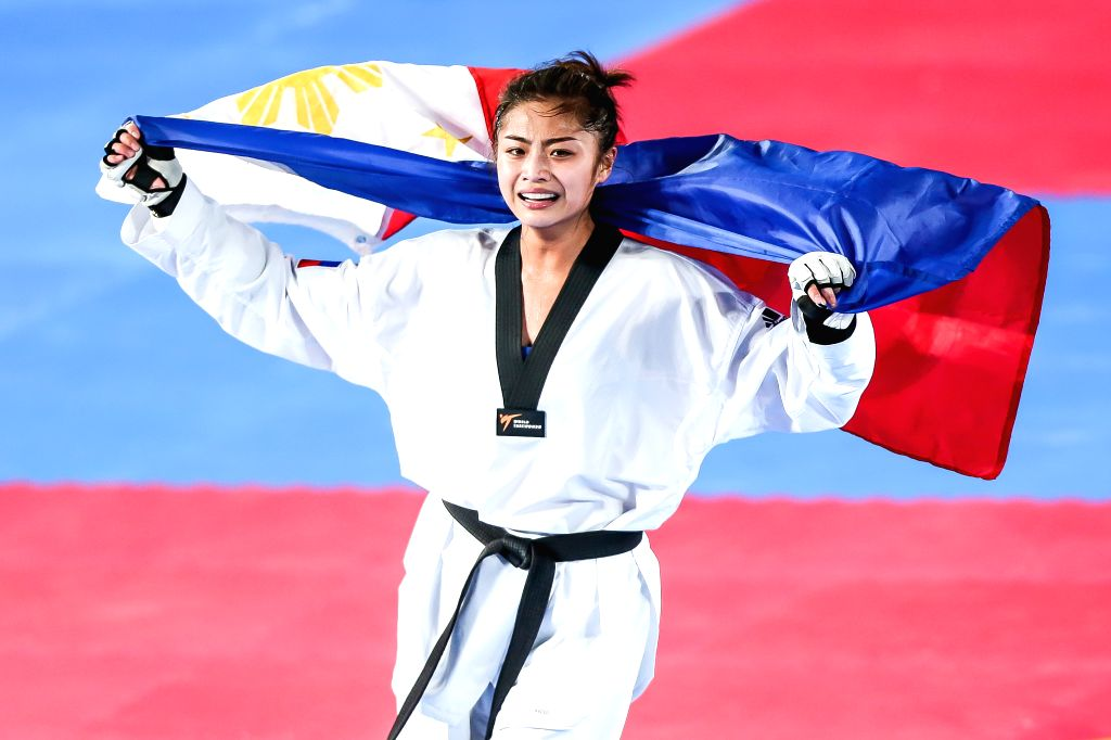 MANILA, Dec. 8, 2019 - Pauline Louise Lopez of the Philippines celebrates after winning Aliza Chhoueng of Cambodia during the women's under 57kg taekwondo final at the Southeast Asian Games 2019 in ...