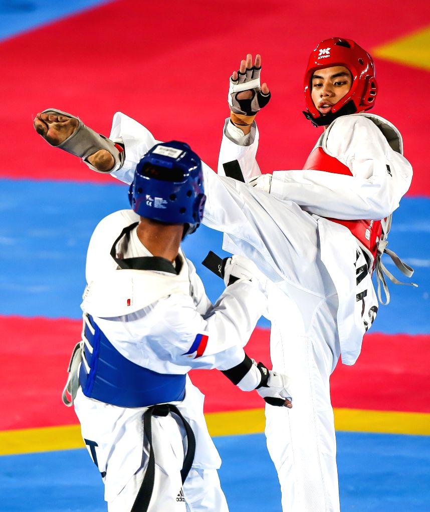 MANILA, Dec. 8, 2019 - Samuel Thomas Harper Morrison (L) of the Philippines competes against Joshua Abdullah of Malaysia during the men's under 80kg taekwondo final at the Southeast Asian Games 2019 ...