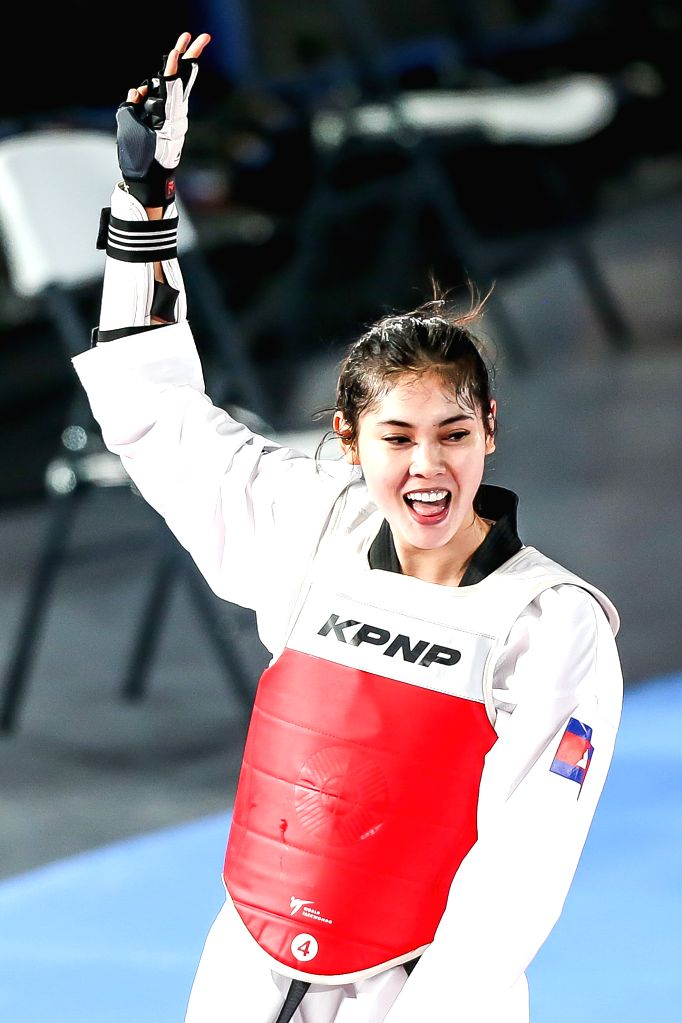 MANILA, Dec. 8, 2019 - Seavmey Sorn of Cambodia celebrates after defeating Kirstie Elaine Alora of the Philippines during the women's under 73kg taekwondo final at the Southeast Asian Games 2019 in ...