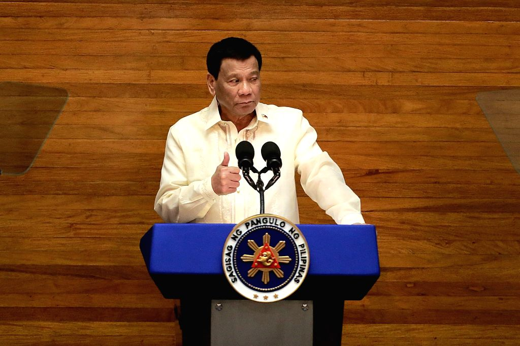 MANILA, July 23, 2018 (Xinhua) -- Philippine President Rodrigo Duterte delivers his third State of the Nation Address at the Philippine House of Representatives in Quezon City, the Philippines, July 23, 2018. Rodrigo Duterte vowed on Monday to intens