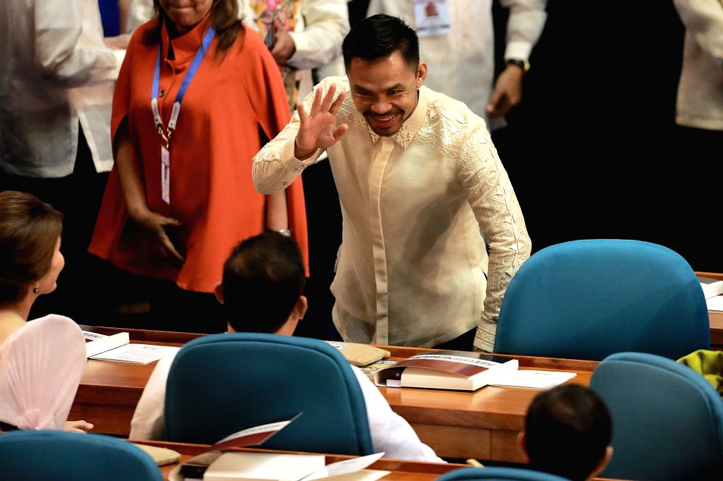 MANILA, July 23, 2018 (Xinhua) -- Philippine Senator and boxing legend Manny Pacquiao is seen as he attends Philippine President Rodrigo Duterte's third State of the Nation Address at the Philippine House of Representatives in Quezon City, the Philip
