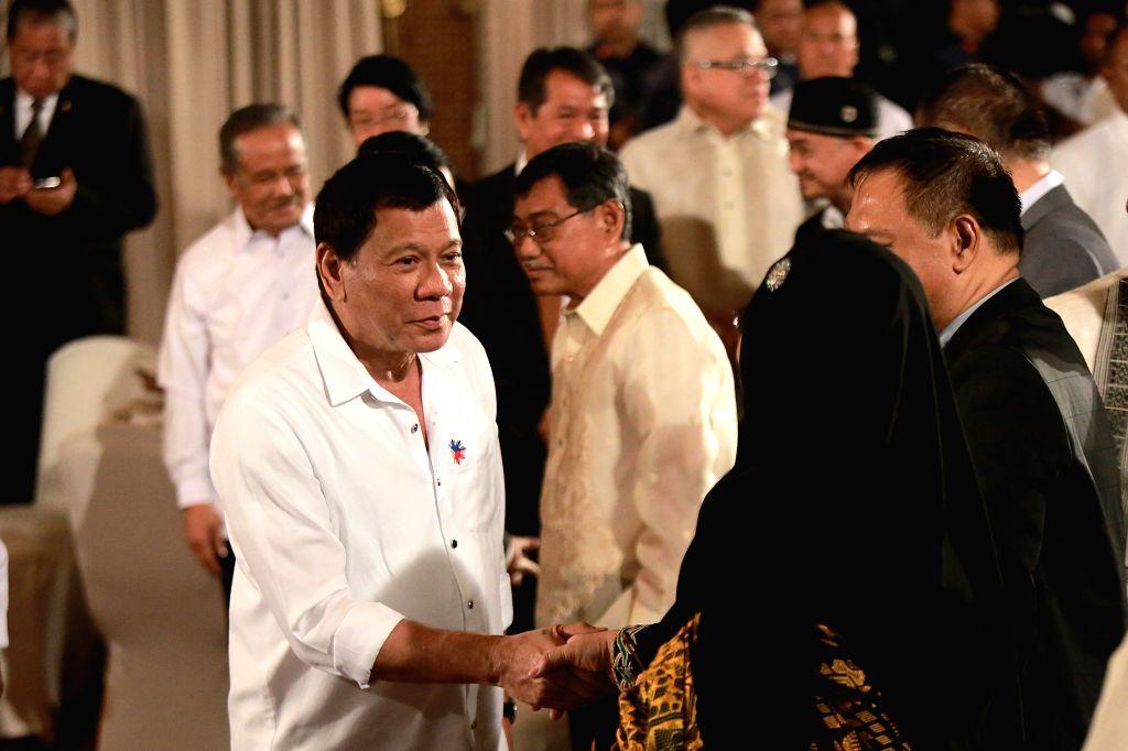 MANILA, Jun. 27, 2017 - Philippine President Rodrigo Duterte meets with Muslim leaders during a celebration of Eid al-Fitr inside Malacanang Palace in Manila, the Philippines, June 27, 2017.