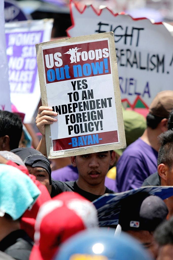 MANILA, June 12, 2017 - An man holds a placard during a protest rally near the U.S. Embassy in Manila, the Philippines, June 12, 2017. The protesters are condemning the intervention of the U.S. ...