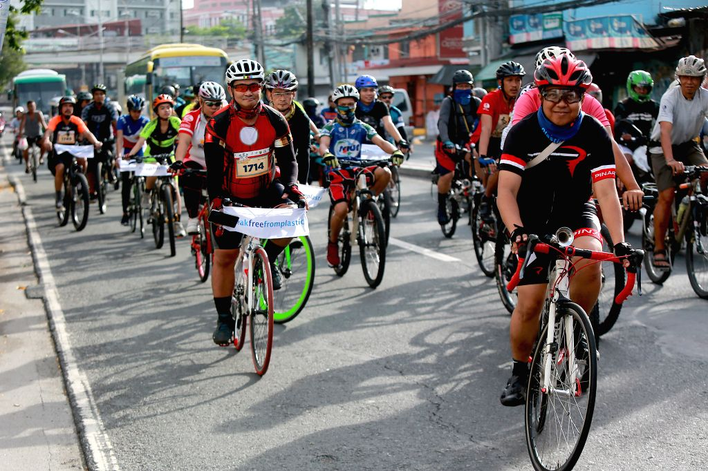 """MANILA, June 3, 2018 - Members from environmental and bicycle groups ride together during a rally commemorating the """"World Bicycle Day"""" and """"International Plastic Bag Free Day"""" in ..."""
