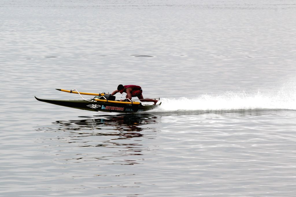A man tests his motorboat before competing at the Manila Bay Seasports Festival in Manila, the Philippines, March 13, 2015. Motorboat and dragonboat racers from ...