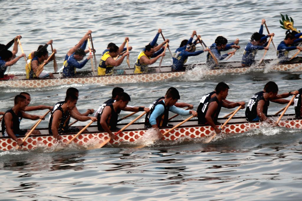 Rowers participate in the dragon boat race event of the 11th Manila Bay Seasports Festival in in Manila, the Philippines, March 15, 2015. The festival features ...