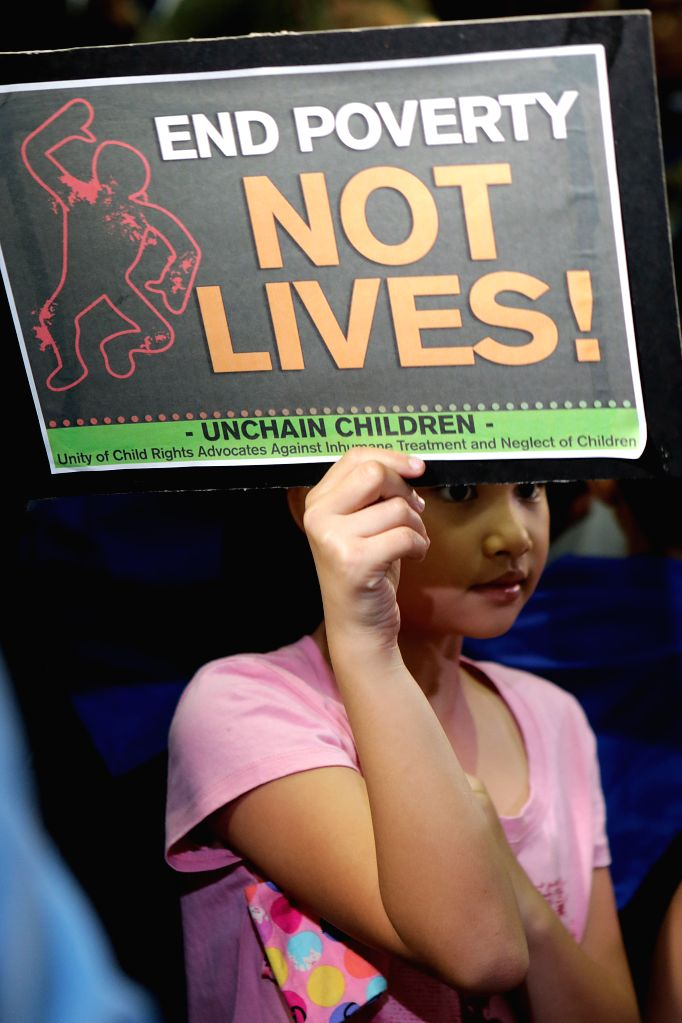 MANILA, March 4, 2017 - A girl holds a placard during an activity for the rights of children in Manila, the Philippines, March 4, 2017. The activity was organized to call for the end of poverty and ...