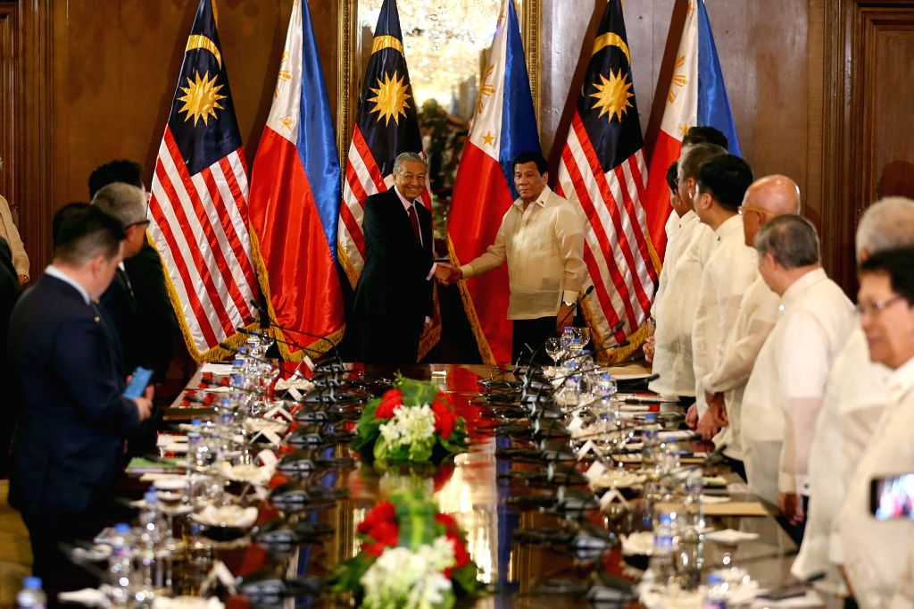 MANILA, March 7, 2019 - Visiting Malaysian Prime Minister Mahathir Mohamad (L, center) shakes hands with Philippine President Rodrigo Duterte (R, center) during a welcoming ceremony at the Malacanang ... - Mahathir Mohamad
