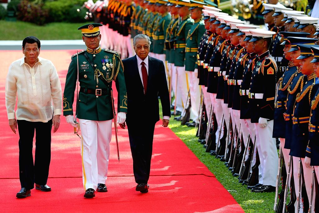 MANILA, March 7, 2019 - Visiting Malaysian Prime Minister Mahathir Mohamad (3rd L) and Philippine President Rodrigo Duterte (1st L) inspect honor guards during a welcoming ceremony at the Malacanang ... - Mahathir Mohamad