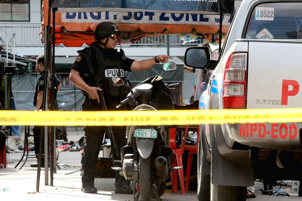 MANILA, May 7, 2017 - Policemen investigate the blast site in Manila, the Philippines, May 7, 2017. Two people were killed and four others injured, including a policeman, in twin blasts that rocked ...