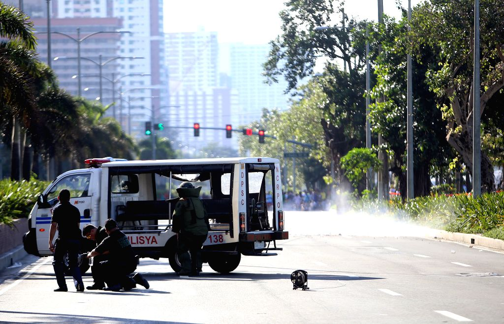 MANILA, Nov. 28, 2016 - Members of the bomb disposal unit of the Philippine National Police (PNP) holds a water bomb disruptor as they prepare to detonate a suspicious package found near the U.S. ...