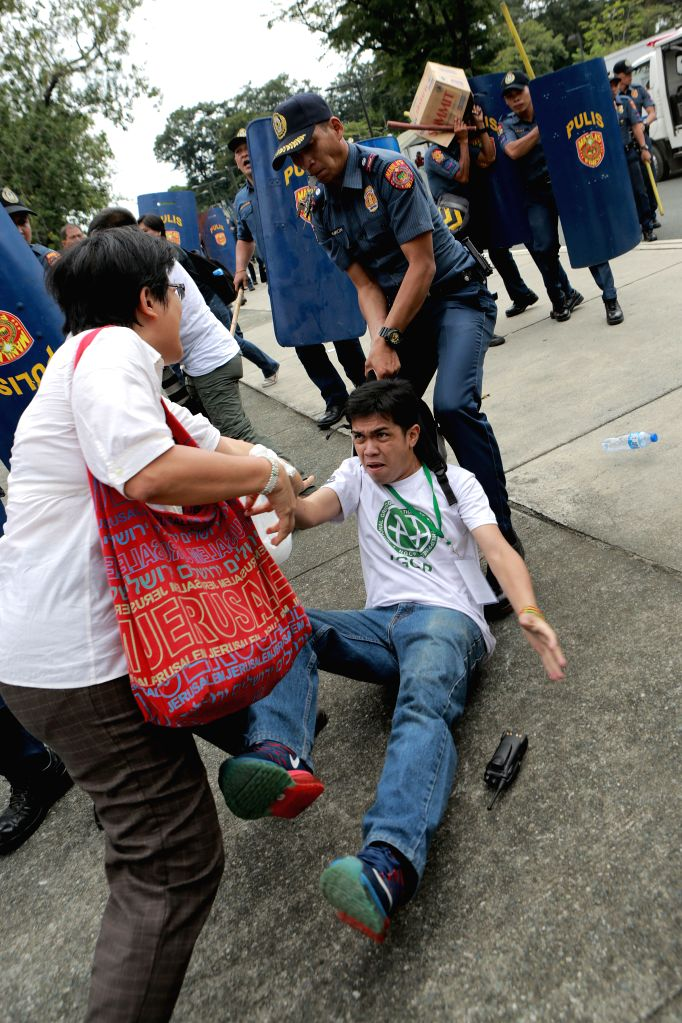 MANILA, Oct. 19, 2016 - A policeman arrests an activist during a violent dispersal of a protest rally in front of the U.S. Embassy in Manila, the Philippines, Oct. 19, 2016. Thousands of Moro and ...