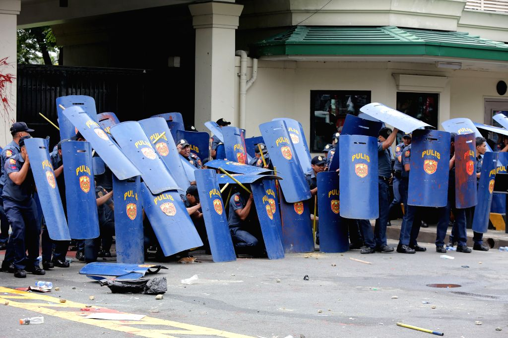 MANILA, Oct. 19, 2016 - Policemen use shields to protect themselves from activists during a violent dispersal of a protest rally in front of the U.S. Embassy in Manila, the Philippines, Oct. 19, ...