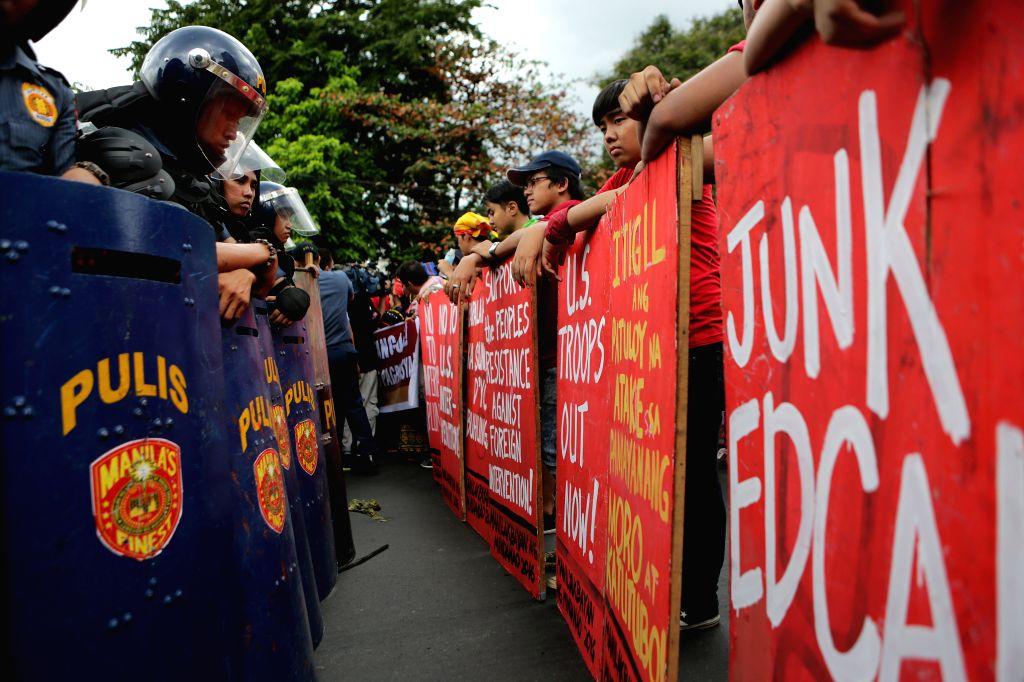MANILA, Oct. 27, 2016 - Indigenous people called Sandugo are blocked by policemen during their protest rally in support of Philippine President Rodrigo Duterte's foreign policy near the U.S. Embassy ...