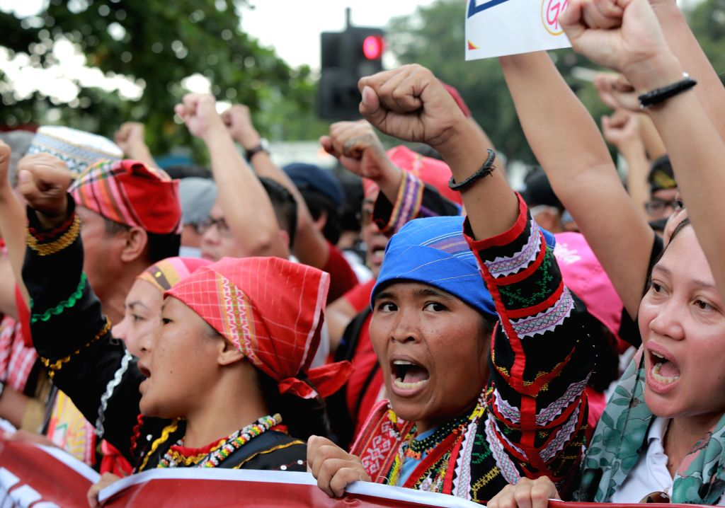MANILA, Oct. 27, 2016 - Indigenous people called Sandugo shout slogans during their protest rally in support of Philippine President Rodrigo Duterte's foreign policy near the U.S. Embassy in Manila, ...