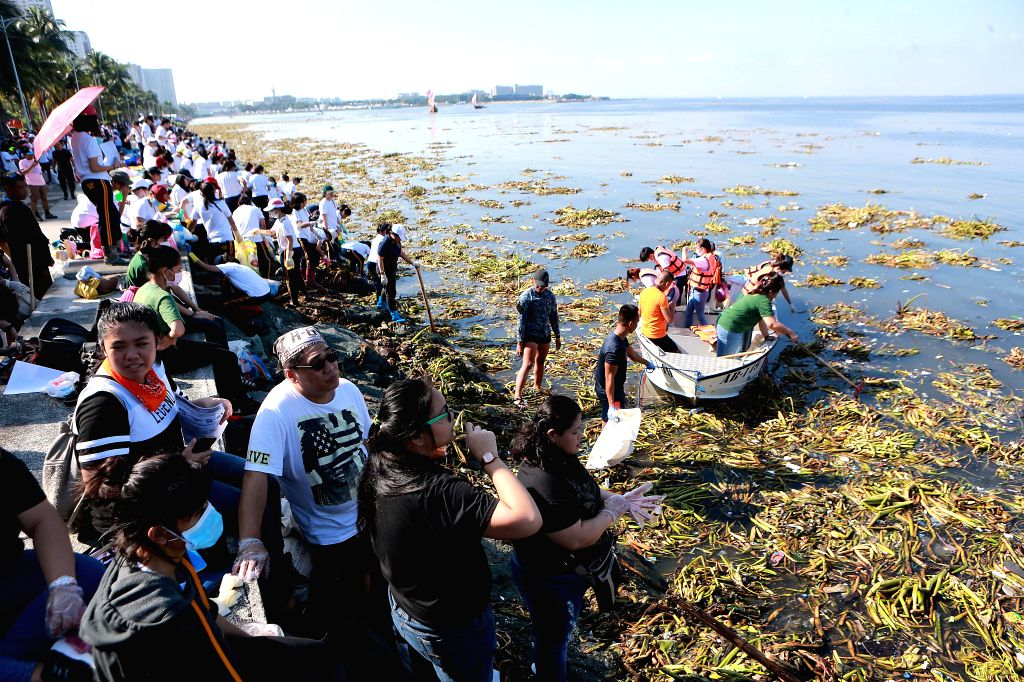 MANILA, Sept. 16, 2017 - Volunteers collect garbage along the coast of Manila Bay during the International Coastal Cleanup Day in Manila, the Philippines, Sept. 16, 2017. International Coastal ...