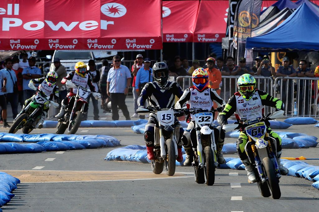 MANILA, Sept. 8, 2018 - Riders compete during the Round 2 of International Motocross Federation Asia Supermoto Championship 2018 in Manila, the Philippines, Sept. 8, 2018.