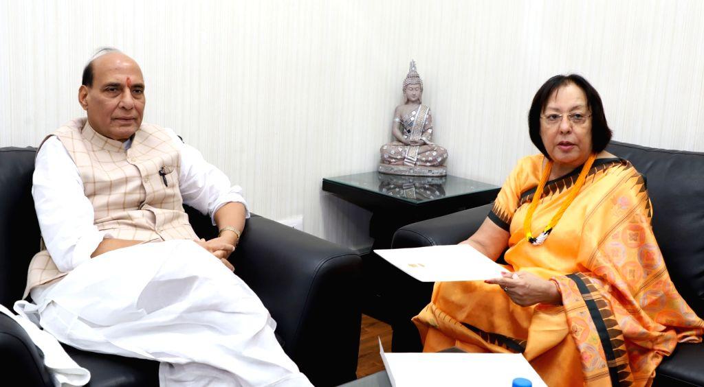 Manipur Governor Najma Heptulla calls on Union Home Minister Rajnath Singh in New Delhi on Sept 16, 2017. - Rajnath Singh and Najma Heptulla