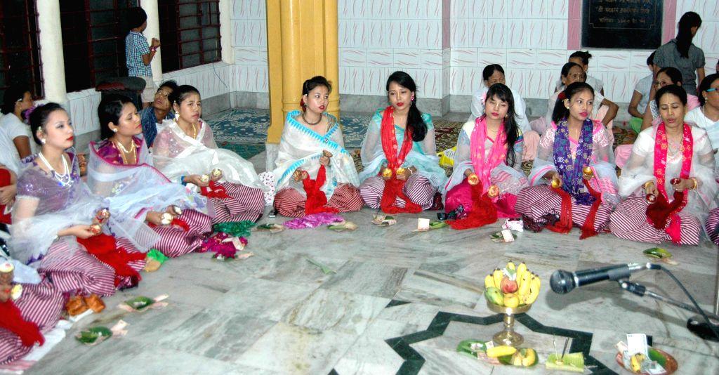Manipuri women perform `Jhulan Esai`  on Jhulan Yatra at Jagannath Mandir in Guwahati on Aug 11, 2014.