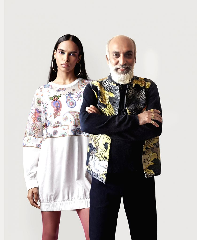 Manish Arora with a model in one of his designs. - Manish Arora