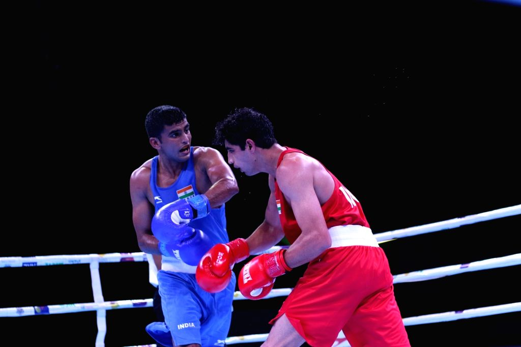 Manish Kaushik beat four-time Asian Championships medallist Shiva Thapa to find a berth in the eight-member squad.