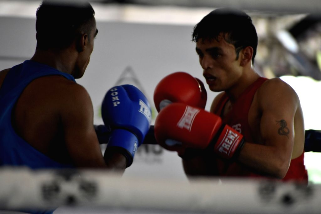 Manjeet of Himachal Pradesh in action against Ankit Chauhan of Uttar Pradesh during the 4th Elite National Boxing Championship in the middleweight (75kg) category, at Baddi University of ... - Ankit Chauhan