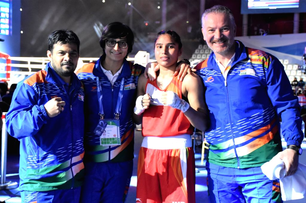 Manju Rani along with the coaches after her historic win.