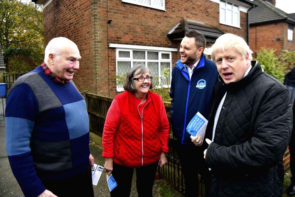 MANSFIELD, Nov. 17, 2019 - Britain's Prime Minister Boris Johnson (1st R) speaks to members of the public as he accompanies Conservative party candidate for the Mansfield constituency Ben Bradley ... - Boris Johnson