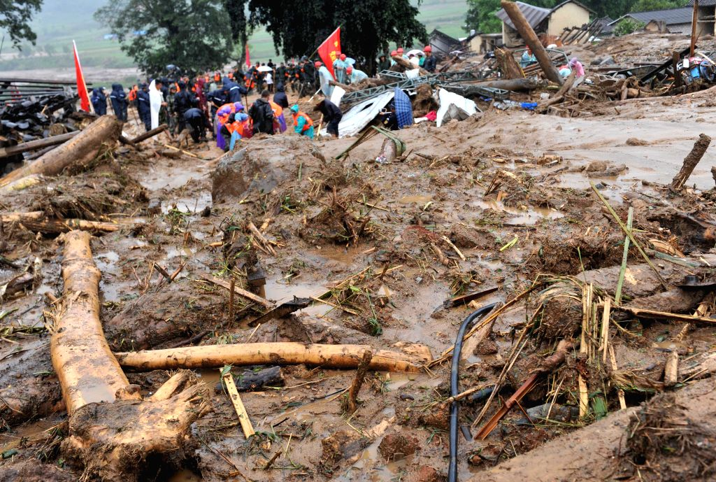 Rescuers conduct rescue work at the site of a mudslide in Lyuying Village of Manghai Town, Mangshi City, Dai-Jingpo Autonomous Prefecture of Dehong, southwest ...