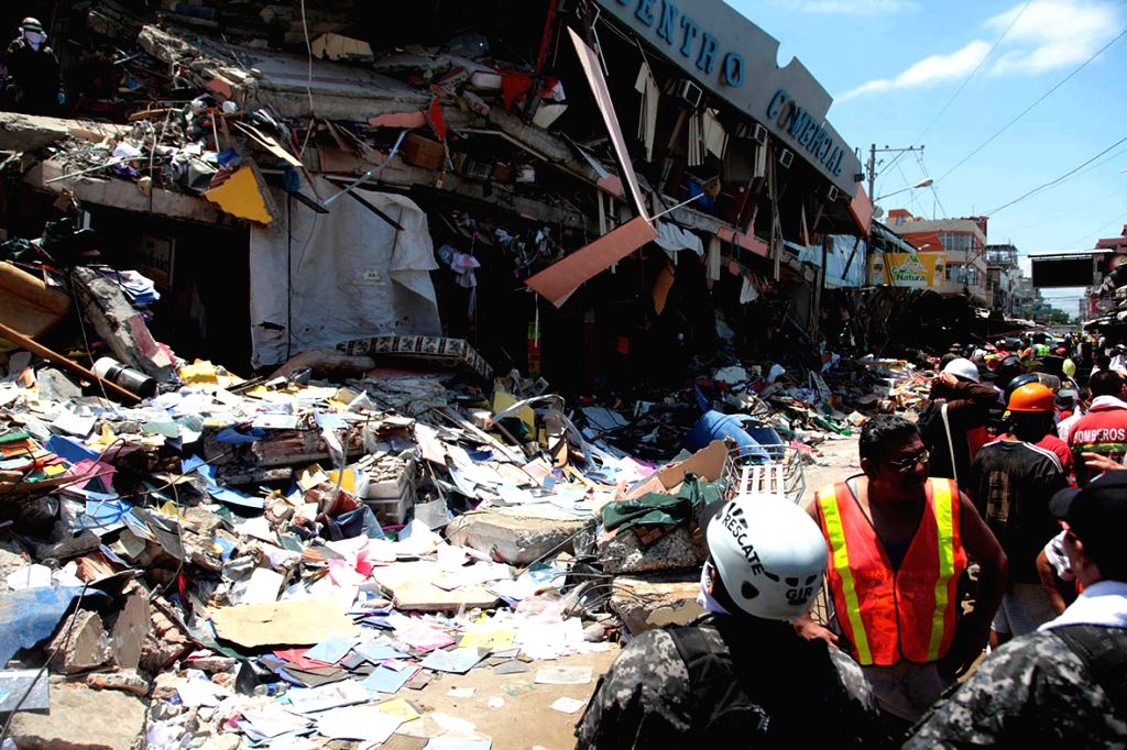 MANTA, April 19, 2016 - Image provided by Ecuador's El Comercio shows rescuers removing rubble after the earthquake in Manta, province of Manabi, Ecuador, on April 18, 2016. The death toll of a ...
