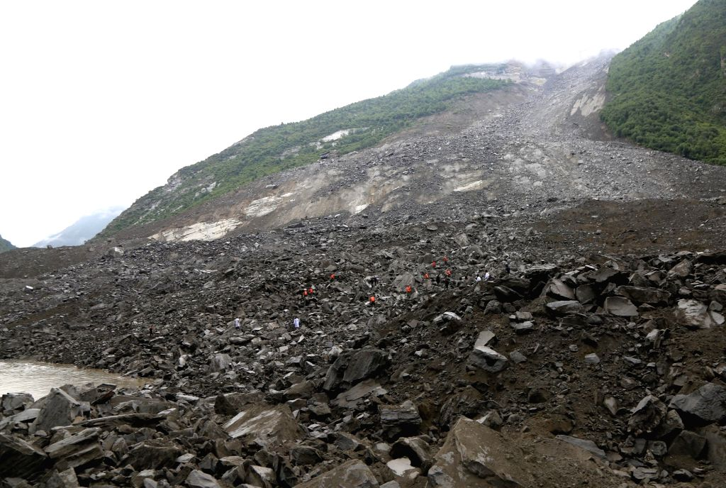 MAOXIAN, June 24, 2017 - Rescuers work at the accident site after a landslide occurred in Xinmo Village of Maoxian County, Tibetan and Qiang Autonomous Prefecture of Aba, southwest China's Sichuan ...