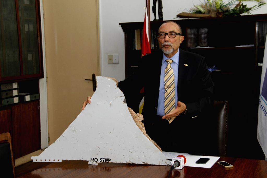 MAPUTO, April 20, 2016 - File photo taken on March 3, 2016 shows Joao de Abreu, director of the National Civil Aviation Institute of Mozambique, displaying a piece of an airplane during a news ...