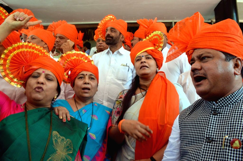 Marathas celebrate after the Maharashtra Legislature unanimously passed a Bill granting 16 per cent reservations to the Maratha community, in Mumbai on Nov 29, 2018. The Marathas have been ...