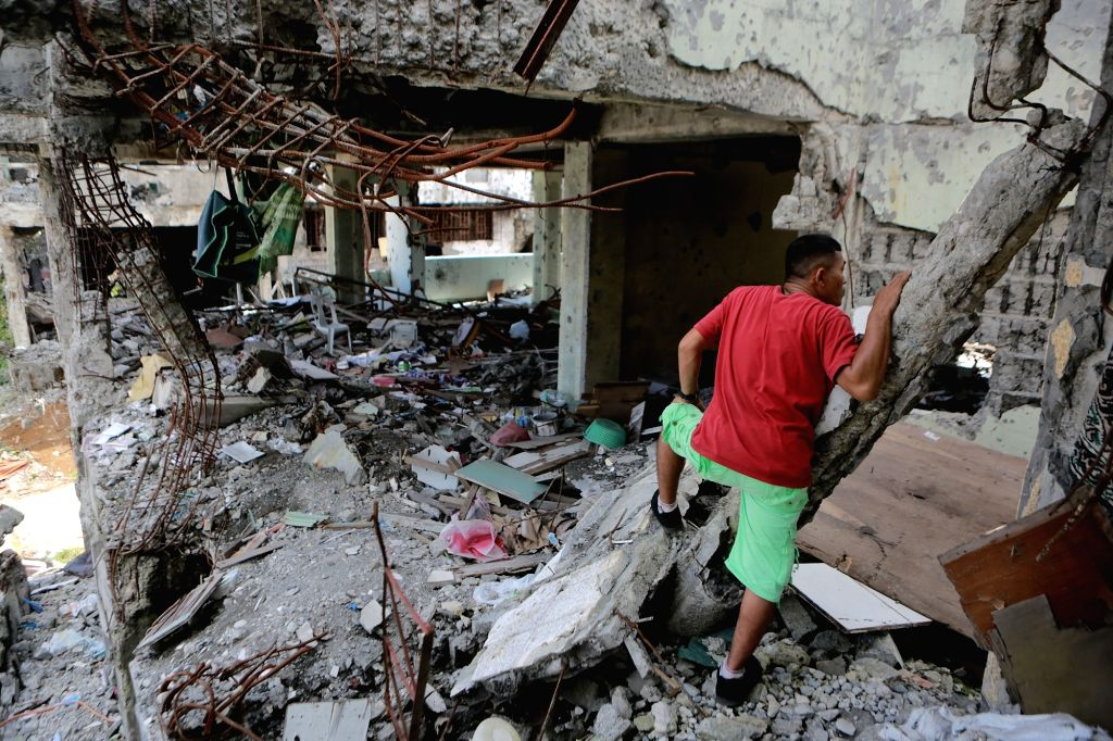 MARAWI CITY, May 22, 2018 - A resident looks at destroyed buildings and houses in the war-torn Marawi City, the Philippines, May 22, 2018. The rehabilitation work in the former battle area in the ...