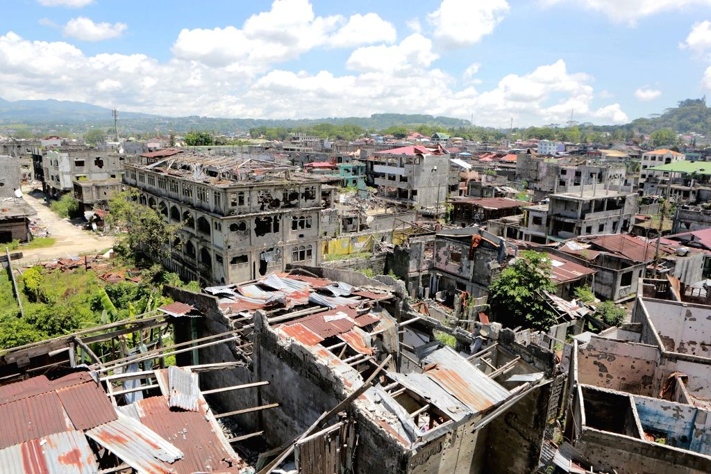 MARAWI CITY, May 22, 2018 - Photo taken on May 22, 2018 shows destroyed building in the war-torn Marawi City, the Philippines.  The rehabilitation work in the former battle area in the war-torn ...