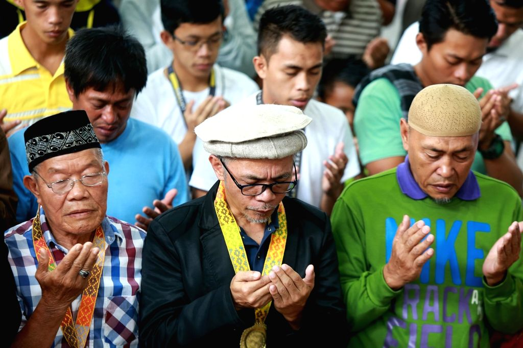 "MARAWI CITY, May 23, 2018 - People pray during the ""Marawi Week of Peace"" in Marawi City, the Philippines, May 23, 2018. The local government and residents held the event to remember those ..."