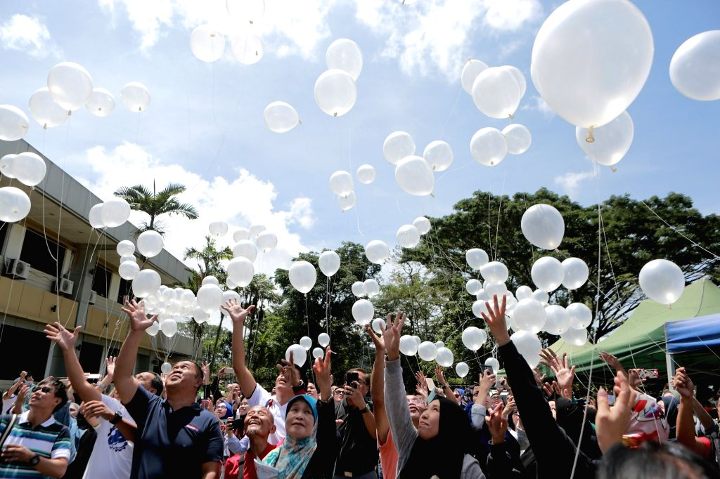 "MARAWI CITY, May 23, 2018 - People release white balloons during the ""Marawi Week of Peace"" in Marawi City, the Philippines, May 23, 2018. The local government and residents held the event ..."