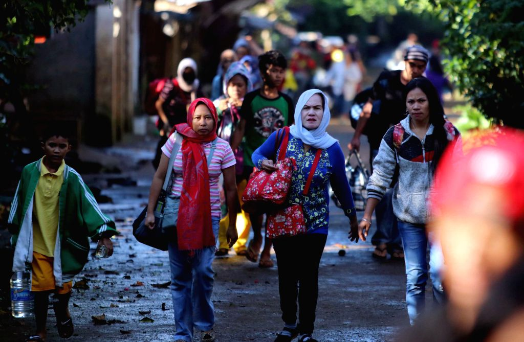 MARAWI CITY, May 27, 2017 - Residents carry their belongings as they evacuate from their homes to a safer place to avoid the crossfire in Lanao Del Sur Province, the Philippines, May 27, 2017. The ...