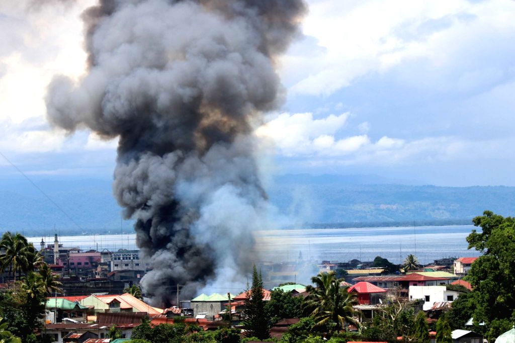MARAWI CITY, May 27, 2017 - Thick smoke billows from a residential area after an airstrike in Lanao Del Sur Province, the Philippines, May 27, 2017. The Philippine security forces continued their ...