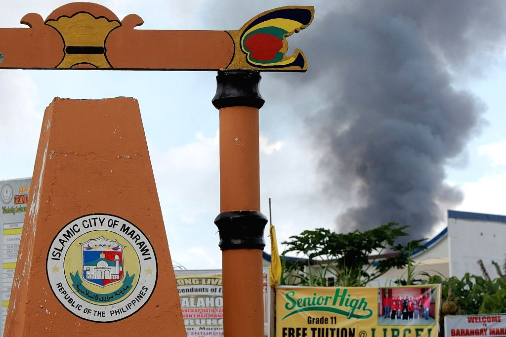 MARAWI CITY, May 31, 2017 - Smoke billows from a residential area after an airstrike by the Philippine Air Force in Marawi City, Lanao Del Sur Province, the Philippines, May 31, 2017. More than 100 ...