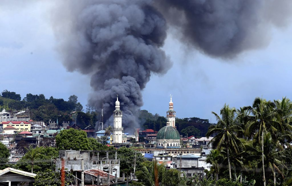 MARAWI, June 27, 2017 - A plume of black smoke billows from downtown of Marawi City, the Philippines, on June 27, 2017. The Philippine government sticks to its policy of no negotiating with extemists ...