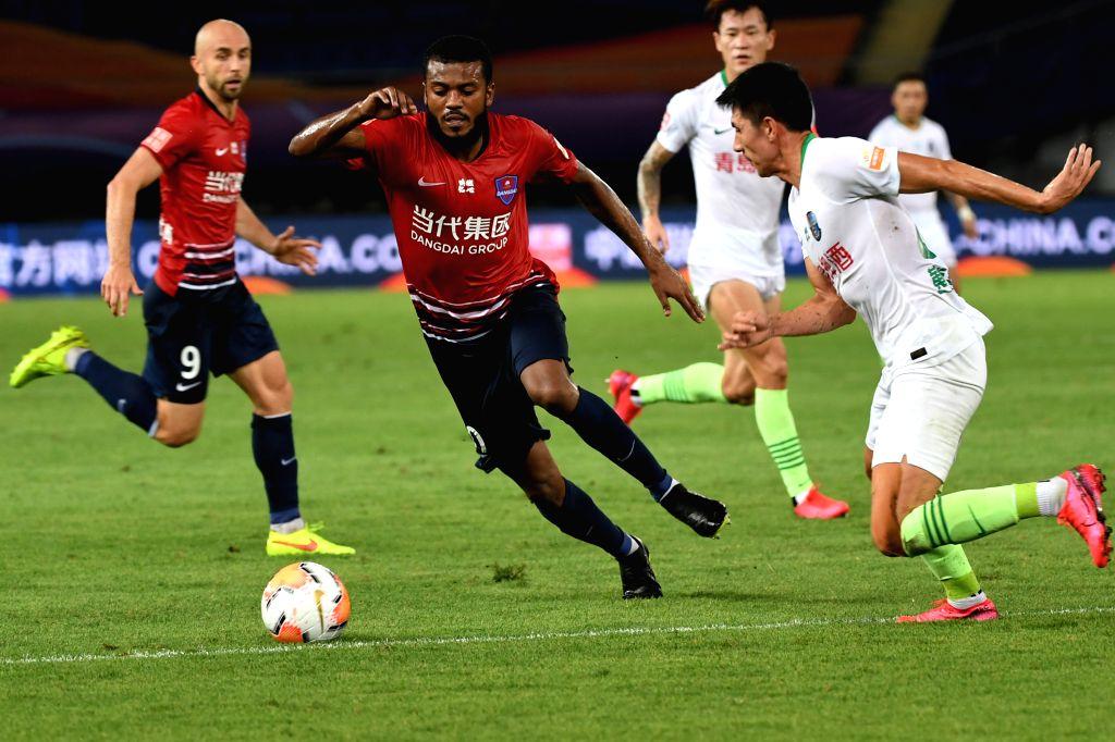 Marcelo Cirino (2nd L) of Chongqing Dangdai Lifan competes during the 4th round match between Chongqing Dangdai Lifan and Qingdao Huanghai at the postponed 2020 ...
